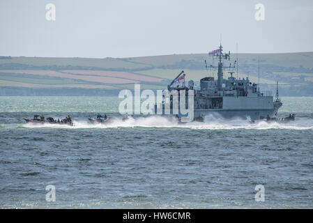 Royal Marines and the Royal Navy mine warfare ship HMS Grimsby in a role demo at the Bournemouth Air Festival, UK - Stock Photo
