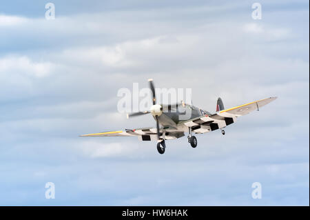 historic british WW2 spitfire fighter on landing approach - Stock Photo