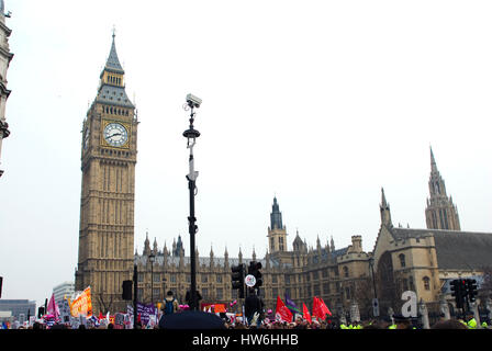 Placards being carried as part of a political protest on Parliament square in front of Big Ben and the Houses of - Stock Photo