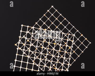 Two tin wire grids with practice solder joints on every intersection, Melbourne 2015 - Stock Photo