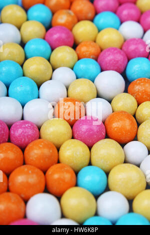 Sugar coated candy bonbon. Chocolate balls with sugar. Colorful sweets. - Stock Photo