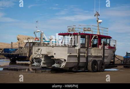 Two large fishing boats on trailers. - Stock Photo
