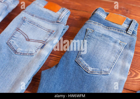 Jeans on a white wooden background. - Stock Photo