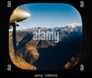 The Himalayas from a propeller plane, Nepal. Flight Kathmandu to Lukla. - Stock Photo