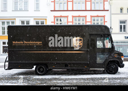 UPS delivery van during snowfall - Stock Photo