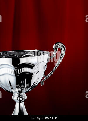 Trophy with a red curtain background - Stock Photo