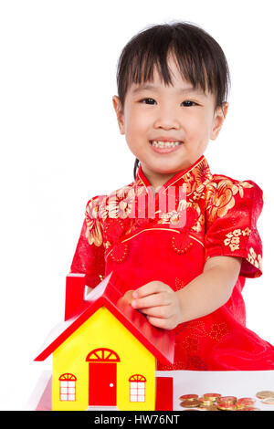 Chinese Little Girl Puts Coins into Piggy Bank isloated on White Background - Stock Photo