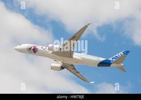 Display flight by a Qatar Airways Airbus A350 at the Farnborough International Airshow, UK - Stock Photo
