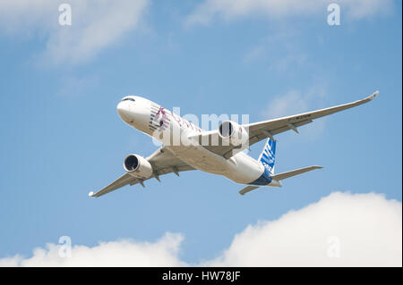 The newly developed Airbus A350 in Qatar Airways livery, in the skies above Farnborough airport, UK - Stock Photo