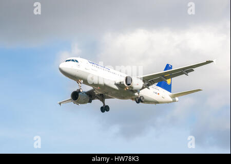 Airbus A320 operated by German national airline Lufthansa on landing approach to London Heathrow Airport, UK - Stock Photo