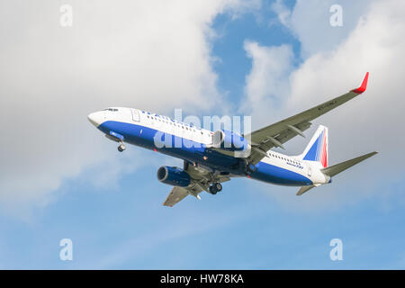 Operated by Russian Federation airline Transaero, a Boeing 737 on landing approach to London Heathrow Airport - Stock Photo