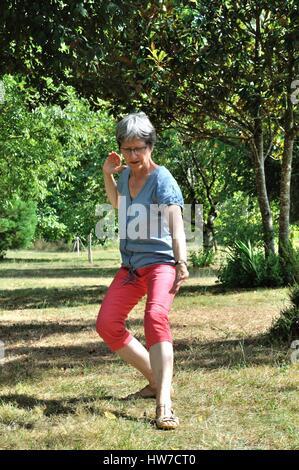 Femme pratiquant le tai chi - Stock Photo