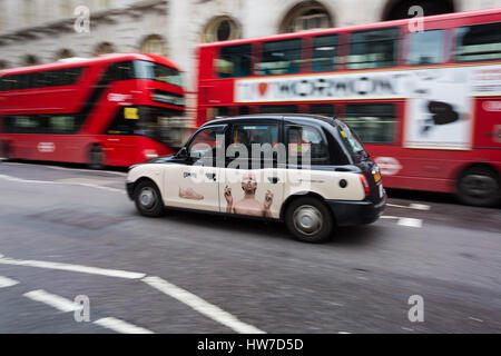 Panned photo of a cab, taxi driving in London, England - Stock Photo