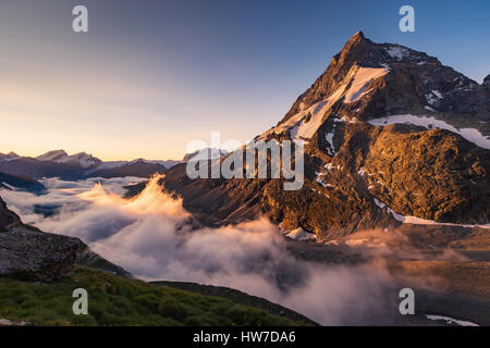 Alpenglow at sunrise on Matterhorn (Cervino) mountain. The north-west side, Zmutt ridge. Zmutt valley, Zermatt, - Stock Photo