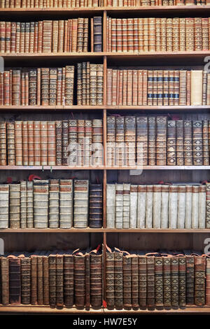 VIENNA, AUSTRIA - AUGUST 14, 2016: Old books on wooden shelves in The State Hall (Prunksaal), the heart of the Austrian - Stock Photo