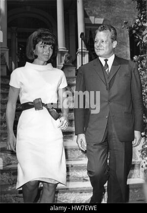 Former first lady Jacqueline Bouvier Kennedy left walks West Berlin Mayor Wily Brandt right to his waiting car in - Stock Photo