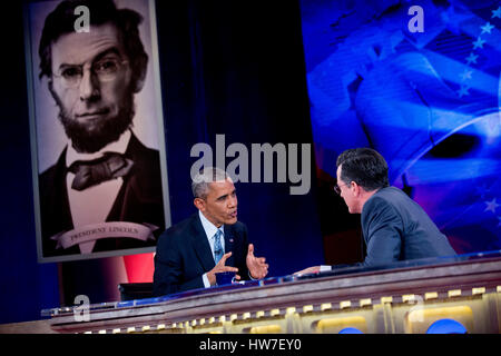 United States President Barack Obama left talks to television personality Stephen Colbert during taping of Comedy - Stock Photo