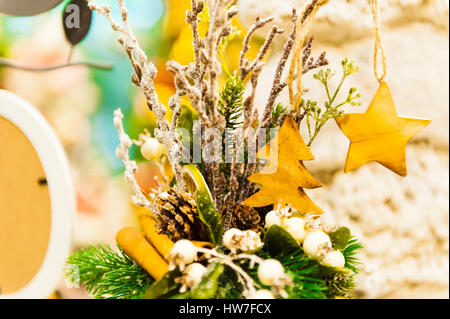Christmas Fir Tree Toys Old wooden star hanging on branch Burning Candles, Boxes, Balls, Pine Cones, Walnuts, Branchesin - Stock Photo