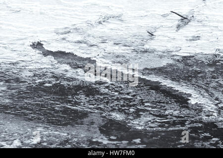Ice on partially frozen river surface - Stock Photo