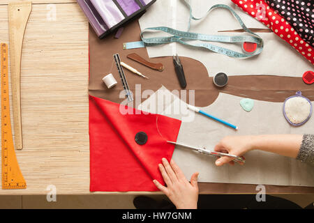 Table of skilled tailors working - Stock Photo
