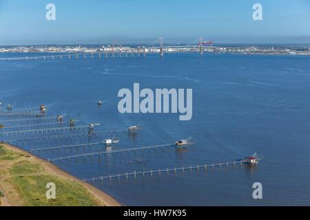 France, Loire Atlantique, Saint Brevin, fisheries on the Loire estuary and Saint Nazaire bridge (aerial view) - Stock Photo