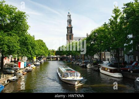 Netherlands, Amsterdam, canal boat in the city center with Westerkerk church in background - Stock Photo