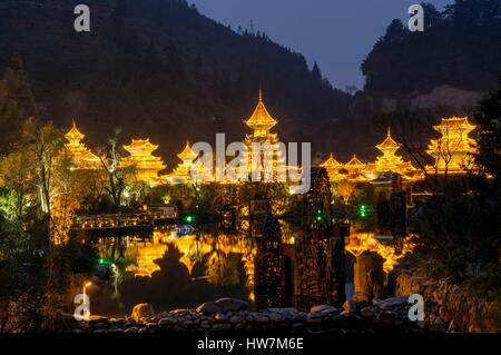 China, Guizhou, Zhaoxing, little capital of the Dong, by night - Stock Photo