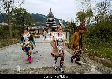 China, Guizhou, Zhaoxing, little capital of the Dong, spring ceremonies, dancers and musician - Stock Photo