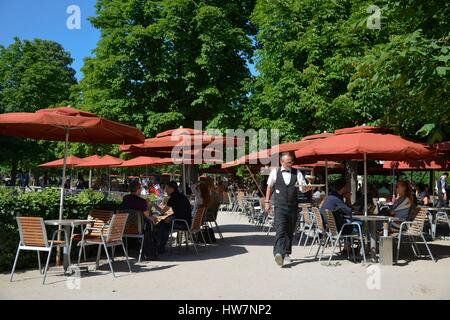 France Paris area listed as World Heritage by UNESCO Garden of the Tuileries waiter in the middle of the tables - Stock Photo