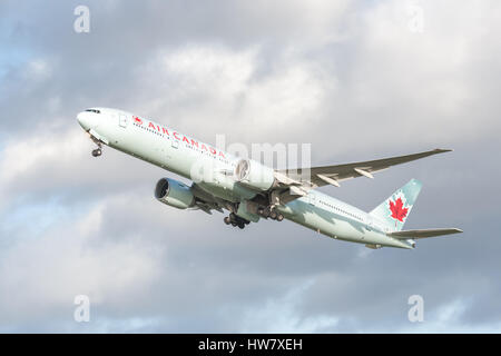 Air Canada Boeing 777-333 (C-FIVW) in arctic green livery, departing Heathrow, UK bound for Vancouver - Stock Photo