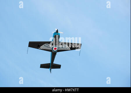 Farnborough, UK - July 19, 2010: Blades aerobatic display aircraft in a steep climb maneuver at the Farnborough - Stock Photo