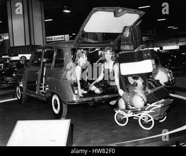 Oct. 10, 1961 - Motor Show Opens at Earl's Court. Photo Shows: Susan and Jennifer Baker, of Finchley, twins who - Stock Photo