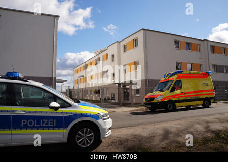 Nauen, Germany. 18th Mar, 2017. A police car and an ambulance park in front of a refugee home in Nauen, Germany, - Stock Photo