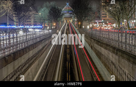 Berlin, Germany. 7th Mar, 2017. Moving underground trains leave tracks of light on a long-exposure shot photographed - Stock Photo