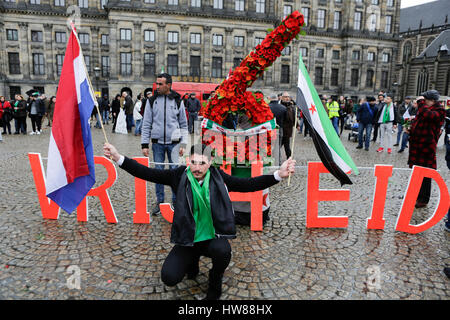 Amsterdam, Netherlands. 18th March 2017. Syrians pose with a Dutch and a Syria Independence flag at a number 6 made - Stock Photo