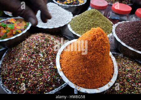 India, Gujarat State, Ahmedabad, listed as World Heritage by UNESCO, bowls of spices and sweets on an Indian market - Stock Photo