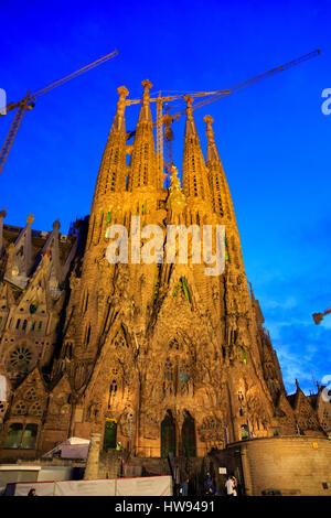 Antonio Gaudi's La Sagrada Familia Basillica lit at night. Barcelona, Catluny, Spain - Stock Photo