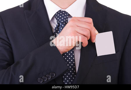 Businessman putting blank card in his pocket. - Stock Photo
