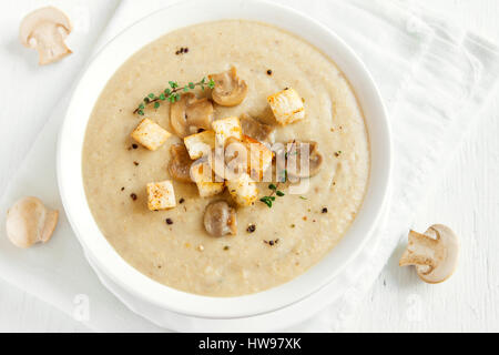 Mushroom Cream Soup With Croutons Herbs And Spices Over White Background Close Up Homemade