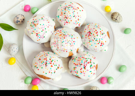 Easter pastry. Fresh Homemade Carrot Mini Cakes with White Creamy Sugar Icing and Colorful Decor. Easter Cakes for - Stock Photo