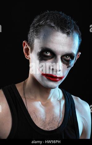 Spooky man on black background - Stock Photo