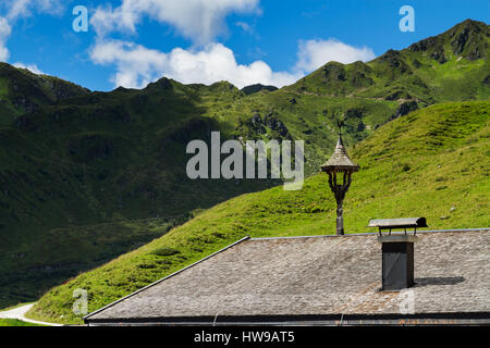 Roof of old house with view on mountains. Alpine landscape along the Zillertal high road, Austria, Tyrol - Stock Photo