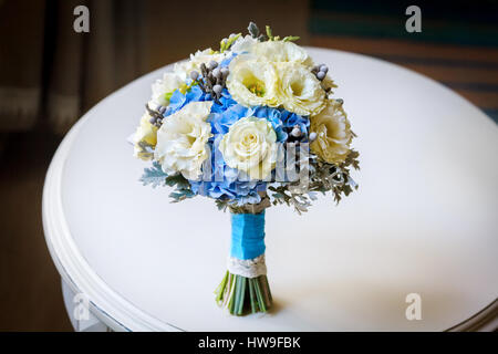 Wedding bouquet of yellow roses and other flowers - Stock Photo