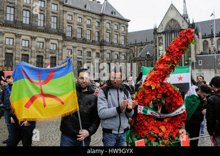 Amsterdam, Netherlands. 18th Mar, 2017. Two men pose with a berber flag at a number 6 made from flowers. Syrians - Stock Photo