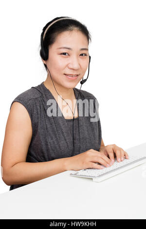 Asian Woman with Headset Using Keyboard in Isolated White Background - Stock Photo