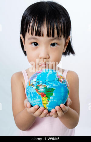 Asian Little Chinese Girl Holding a World Globe in isolated White Background - Stock Photo