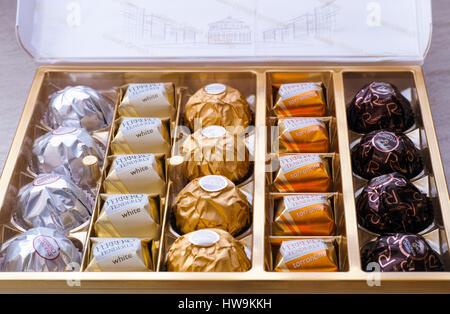 Paphos, Cyprus - November 20, 2016 Open box of Ferrero candies. - Stock Photo