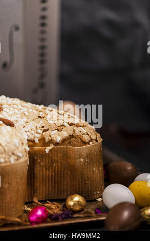 Easter bunny, eggs and cake, over a dark rusty tray - Stock Photo