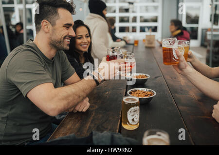 Cheers to a good beer and better friends - Stock Photo
