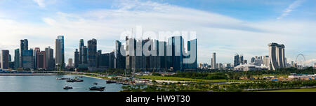 Horizontal panoramic (3 picture stitch) cityscape view of Singapore. - Stock Photo